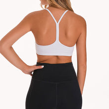 Load image into Gallery viewer, If you are looking for a sports bra that's light and comfortable to layer in, this Solid Y Racerback Strappy Sports Bra - White won't disappoint you. Featuring thin straps and racerback silhouette, this sports bra is perfect for low impact activities from studio to gym, to daily lounging. This racerback sports bra feels weightless, thanks to its minimal design. Buttery soft and breathable fabric makes it comfortable to wear all day long.