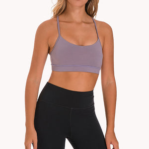 If you are looking for a sports bra that's light and comfortable to layer in, this Solid Y Racerback Strappy Sports Bra - Mystic Purple won't disappoint you. Featuring thin straps and racerback silhouette, this sports bra is perfect for low impact activities from studio to gym, to daily lounging. This racerback sports bra feels weightless, thanks to its minimal design. Buttery soft and breathable fabric makes it comfortable to wear all day long.