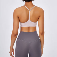 Load image into Gallery viewer, If you are looking for a sports bra that's light and comfortable to layer in, this Solid Y Racerback Strappy Sports Bra - Placid Pink won't disappoint you. Featuring thin straps and racerback silhouette, this sports bra is perfect for low impact activities from studio to gym, to daily lounging. This racerback sports bra feels weightless, thanks to its minimal design. Buttery soft and breathable fabric makes it comfortable to wear all day long.