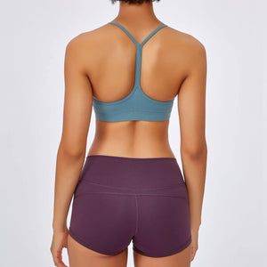 If you are looking for a sports bra that's light and comfortable to layer in, this Solid Y Racerback Strappy Sports Bra - Aqua Blue won't disappoint you. Featuring thin straps and racerback silhouette, this sports bra is perfect for low impact activities from studio to gym, to daily lounging. This racerback sports bra feels weightless, thanks to its minimal design. Buttery soft and breathable fabric makes it comfortable to wear all day long.