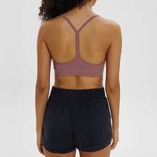 Load image into Gallery viewer, If you are looking for a sports bra that's light and comfortable to layer in, this Solid Y Racerback Strappy Sports Bra - Nostalgia Rose won't disappoint you. Featuring thin straps and racerback silhouette, this sports bra is perfect for low impact activities from studio to gym, to daily lounging. This racerback sports bra feels weightless, thanks to its minimal design. Buttery soft and breathable fabric makes it comfortable to wear all day long.