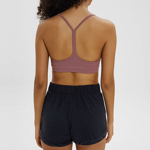 If you are looking for a sports bra that's light and comfortable to layer in, this Solid Y Racerback Strappy Sports Bra - Nostalgia Rose won't disappoint you. Featuring thin straps and racerback silhouette, this sports bra is perfect for low impact activities from studio to gym, to daily lounging. This racerback sports bra feels weightless, thanks to its minimal design. Buttery soft and breathable fabric makes it comfortable to wear all day long.
