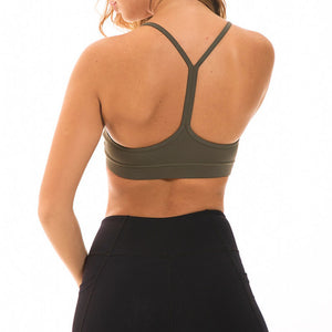 If you are looking for a sports bra that's light and comfortable to layer in, this Solid Y Racerback Strappy Sports Bra - Olive Brown won't disappoint you. Featuring thin straps and racerback silhouette, this sports bra is perfect for low impact activities from studio to gym, to daily lounging. This racerback sports bra feels weightless, thanks to its minimal design. Buttery soft and breathable fabric makes it comfortable to wear all day long.