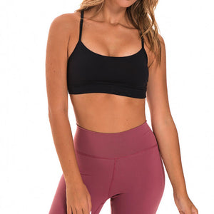 If you are looking for a sports bra that's light and comfortable to layer in, this Solid Y Racerback Strappy Sports Bra - Black won't disappoint you. Featuring thin straps and racerback silhouette, this sports bra is perfect for low impact activities from studio to gym, to daily lounging. This racerback sports bra feels weightless, thanks to its minimal design. Buttery soft and breathable fabric makes it comfortable to wear all day long.