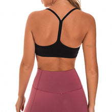 Load image into Gallery viewer, If you are looking for a sports bra that's light and comfortable to layer in, this Solid Y Racerback Strappy Sports Bra - Black won't disappoint you. Featuring thin straps and racerback silhouette, this sports bra is perfect for low impact activities from studio to gym, to daily lounging. This racerback sports bra feels weightless, thanks to its minimal design. Buttery soft and breathable fabric makes it comfortable to wear all day long.