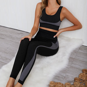Hummingbird Solid & Striped Seamless Sports Set - Black comes as a flattering crop tank top sports bra with square neck and low cut back, and a pair of high waisted leggings.