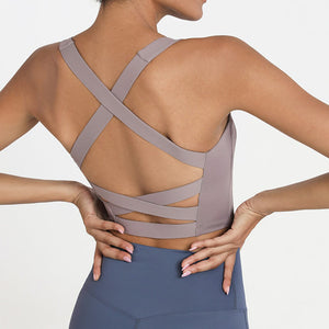 Bring style to the yoga studio in this Strappy Crisscross Padded Crop Tank Sports Bra - Teaberry Grey. Featuring square neck and full-on wide crisscross straps on the back, this Strappy Crisscross Padded Crop Tank Sports Bra is ideal for low to medium impact activities such as yoga and weight training. With 14-16 inch / 37-41 cm shortened length, this flattering padded crop tank top kisses your high waisted leggings, and is easy to layer. Complete the look with our Solid Hidden Pocket 7/8 Leggings.