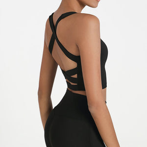 Bring style to the yoga studio in this Strappy Crisscross Padded Crop Tank Sports Bra - Black. Featuring square neck and full-on wide crisscross straps on the back, this Strappy Crisscross Padded Crop Tank Sports Bra is ideal for low to medium impact activities such as yoga and weight training. With 14-16 inch / 37-41 cm shortened length, this flattering padded crop tank top kisses your high waisted leggings, and is easy to layer. Complete the look with our Solid Hidden Pocket 7/8 Leggings.