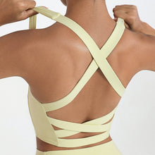 Load image into Gallery viewer, Bring style to the yoga studio in this Strappy Crisscross Padded Crop Tank Sports Bra - Cream. Featuring square neck and full-on wide crisscross straps on the back, this Strappy Crisscross Padded Crop Tank Sports Bra is ideal for low to medium impact activities such as yoga and weight training. With 14-16 inch / 37-41 cm shortened length, this flattering padded crop tank top kisses your high waisted leggings, and is easy to layer. Complete the look with our Solid Hidden Pocket 7/8 Leggings.