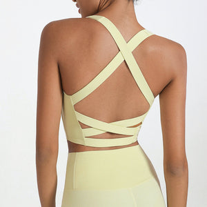 Bring style to the yoga studio in this Strappy Crisscross Padded Crop Tank Sports Bra - Cream. Featuring square neck and full-on wide crisscross straps on the back, this Strappy Crisscross Padded Crop Tank Sports Bra is ideal for low to medium impact activities such as yoga and weight training. With 14-16 inch / 37-41 cm shortened length, this flattering padded crop tank top kisses your high waisted leggings, and is easy to layer. Complete the look with our Solid Hidden Pocket 7/8 Leggings.