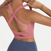 Load image into Gallery viewer, Bring style to the yoga studio in this Strappy Crisscross Padded Crop Tank Sports Bra - Cherry Rose. Featuring square neck and full-on wide crisscross straps on the back, this Strappy Crisscross Padded Crop Tank Sports Bra is ideal for low to medium impact activities such as yoga and weight training. With 14-16 inch / 37-41 cm shortened length, this flattering padded crop tank top kisses your high waisted leggings, and is easy to layer. Complete the look with our Solid Hidden Pocket 7/8 Leggings.