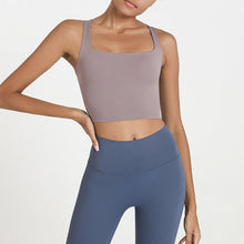 Load image into Gallery viewer, Bring style to the yoga studio in this Strappy Crisscross Padded Crop Tank Sports Bra - Teaberry Grey. Featuring square neck and full-on wide crisscross straps on the back, this Strappy Crisscross Padded Crop Tank Sports Bra is ideal for low to medium impact activities such as yoga and weight training. With 14-16 inch / 37-41 cm shortened length, this flattering padded crop tank top kisses your high waisted leggings, and is easy to layer. Complete the look with our Solid Hidden Pocket 7/8 Leggings.