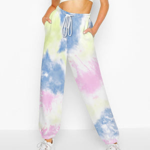 Hummingbird Tie Dye Print Drawstring Joggers - Pastel B features loose fit with elastic waistband and cuffed hem, an adjustable drawstring and side pockets. Perfect for any daily activities from workout to casual lounging. Digital printing technology keeps tie dye patterns intact after wear and tear. Complete the look with a sweatshirt, sports bra, crop top, crop tank and more because they go with almost anything in your closet!
