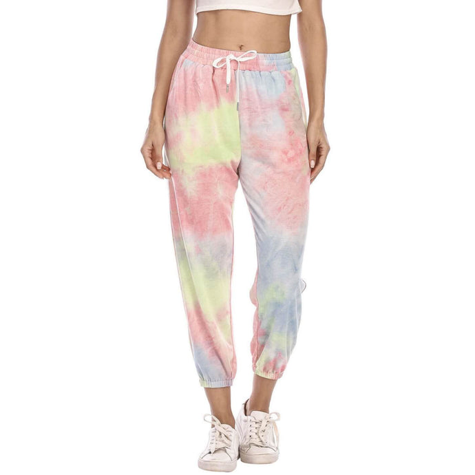 Hummingbird Pastel Tie Dye Drawstring Joggers - Pink & Yellow & Blue features loose fit with elastic waistband and cuffed hems, an adjustable drawstring and side pockets. Perfect for any daily activities from workout to casual lounging. Due to the nature of tie dye, each joggers are slightly different and have their unique patterns, which means you can't find the same joggers anywhere else! Made of stretchy and soft material.