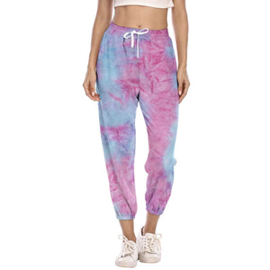 Hummingbird Pastel Tie Dye Drawstring Joggers - Blue & Blush features loose fit with elastic waistband and cuffed hems, an adjustable drawstring and side pockets. Perfect for any daily activities from workout to casual lounging. Due to the nature of tie dye, each joggers are slightly different and have their unique patterns, which means you can't find the same joggers anywhere else! Made of stretchy and soft material.
