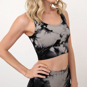 Bring some retro fun to your daily workout with this Tie Dye Ribbed Seamless Leggings & Crop Tank Set - Black! Crop tank top sports bra features a long line silhouette and scoop neckline. Leggings are high-waist fitted with widened waistband and ribbed ankles. This formfitting 2-piece matching workout set is perfect for all sorts of indoor and outdoor activities, as well as post-exercise errand running.