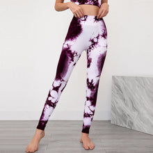 Load image into Gallery viewer, Bring some retro fun to your daily workout with this Tie Dye Ribbed Seamless Leggings & Crop Tank Set - Purple! Crop tank top sports bra features a long line silhouette and scoop neckline. Leggings are high-waist fitted with widened waistband and ribbed ankles. This formfitting 2-piece matching workout set is perfect for all sorts of indoor and outdoor activities, as well as post-exercise errand running.