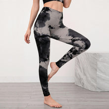 Load image into Gallery viewer, Bring some retro fun to your daily workout with this Tie Dye Ribbed Seamless Leggings & Crop Tank Set - Black! Crop tank top sports bra features a long line silhouette and scoop neckline. Leggings are high-waist fitted with widened waistband and ribbed ankles. This formfitting 2-piece matching workout set is perfect for all sorts of indoor and outdoor activities, as well as post-exercise errand running.
