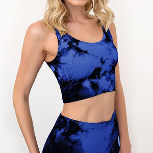 Bring some retro fun to your daily workout with this Tie Dye Ribbed Seamless Leggings & Crop Tank Set - Blue! Crop tank top sports bra features a long line silhouette and scoop neckline. Leggings are high-waist fitted with widened waistband and ribbed ankles. This formfitting 2-piece matching workout set is perfect for all sorts of indoor and outdoor activities, as well as post-exercise errand running.