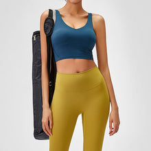 Load image into Gallery viewer, Take your active look from studio to street with this V Neck Crop Tank Top Longline Sports Bra - Teal Blue. Featuring v neckline and low cut scoop back, this fitted crop tank top is ideal for low impact activities, be it for workouts, running errands or lounging. With a 14-16 inch / 37-41 cm length, this cute longline sports bra kisses your high waisted pants, and is easy to layer. Perfect for low impact exercise like weight training, yoga, cycling, spinning, dancing and more.