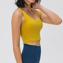Load image into Gallery viewer, Take your active look from studio to street with this V Neck Crop Tank Top Longline Sports Bra - Mustard Yellow. Featuring v neckline and low cut scoop back, this fitted crop tank top is ideal for low impact activities, be it for workouts, running errands or lounging. With a 14-16 / 37-41 cm inch length, this cute longline sports bra kisses your high waisted pants, and is easy to layer. Perfect for low impact exercise like weight training, yoga, cycling, spinning, dancing and more.