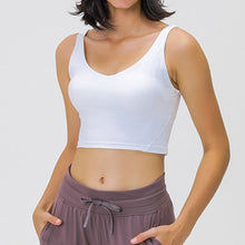 Load image into Gallery viewer, Take your active look from studio to street with this V Neck Crop Tank Top Longline Sports Bra - White. Featuring v neckline and low cut scoop back, this fitted crop tank top is ideal for low impact activities, be it for workouts, running errands or lounging. With a 14-16 inch / 37-41 cm length, this cute longline sports bra kisses your high waisted pants, and is easy to layer. Perfect for low impact exercise like weight training, yoga, cycling, spinning, dancing and more.