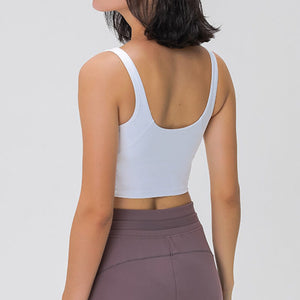Take your active look from studio to street with this V Neck Crop Tank Top Longline Sports Bra - White. Featuring v neckline and low cut scoop back, this fitted crop tank top is ideal for low impact activities, be it for workouts, running errands or lounging. With a 14-16 inch / 37-41 cm length, this cute longline sports bra kisses your high waisted pants, and is easy to layer. Perfect for low impact exercise like weight training, yoga, cycling, spinning, dancing and more.
