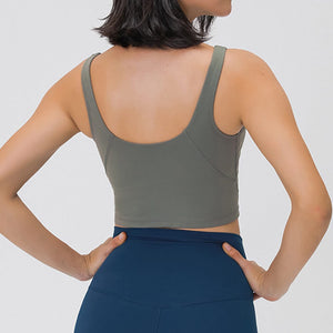 Take your active look from studio to street with this V Neck Crop Tank Top Longline Sports Bra - Smoky Green. Featuring v neckline and low cut scoop back, this fitted crop tank top is ideal for low impact activities, be it for workouts, running errands or lounging. With a 14-16 inch / 37-41 cm length, this cute longline sports bra kisses your high waisted pants, and is easy to layer. Perfect for low impact exercise like weight training, yoga, cycling, spinning, dancing and more.