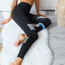 Load image into Gallery viewer, Hummingbird Vintage Striped Cropped Leggings with asymmetric white and blue stripes on them. Perfect workout wear.