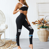 Hummingbird Vintage Striped Sports Set containing a Black & White Sports Bra with back straps and a pair of Vintage Striped Cropped Leggings with asymmetric white and blue stripes on them