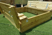 Sandpit with folding benches