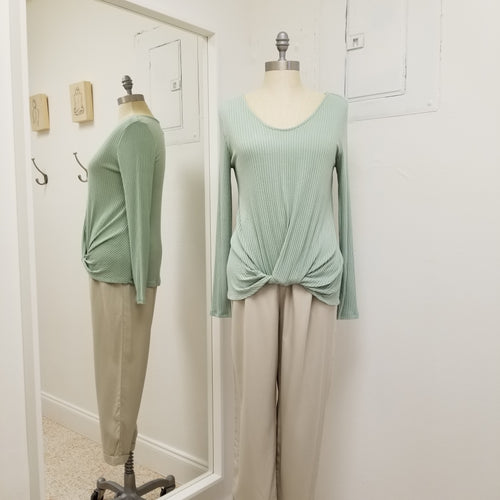 sage soft rib knit lightweight long sleeve top with round collar and front twist, hits below the waistband