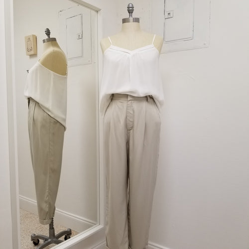 light taupe tencel pleated front pants with zipper front and back elastic at waist , slight cuff at ankle