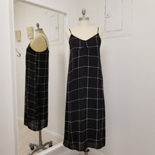Load image into Gallery viewer, black and white dress strappy mid length dress fully lined, black background with wide checked pattern in white
