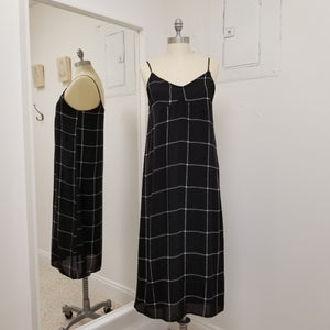 black and white dress strappy mid length dress fully lined, black background with wide checked pattern in white