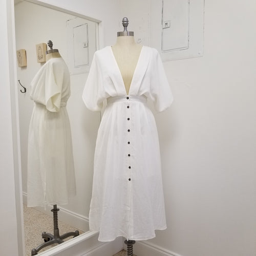 short sleeve button front plunged neckline white mid length dress with elastic at back and fully lined