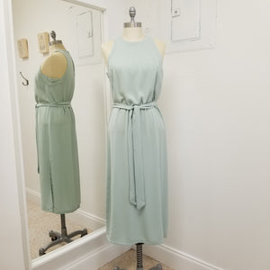 pale mint green sleeveless mid length shift style dress with tie at waist and slits on side