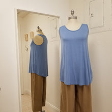 Load image into Gallery viewer, soft powder blue tank with slight racer back  and hi lo length