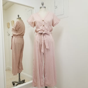 short sleeve dusty pink and white striped cotton linen blend mid length jumpsuit with elastic waist and tie belt, v neck with 3 buttoned top, fully lined