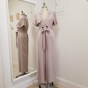 short sleeve full length wide leg beige jumpsuit with elastic waist, front wrap style top, tie belt at waist