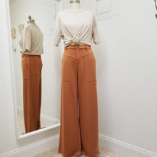 Load image into Gallery viewer, high waisted sandy rust pants with wide leg oversized front pockets and front zipper closure