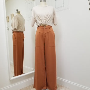 high waisted sandy rust pants with wide leg oversized front pockets and front zipper closure