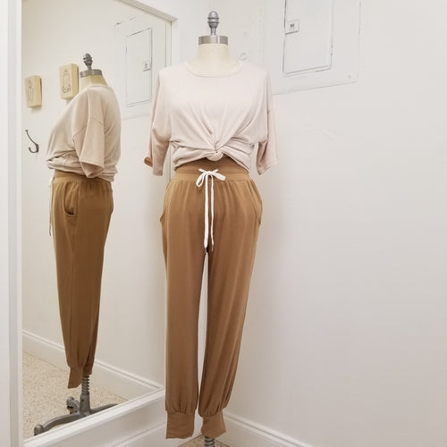 jog pants with drawstring and wide elastic waistband, front pockets and banded ankles