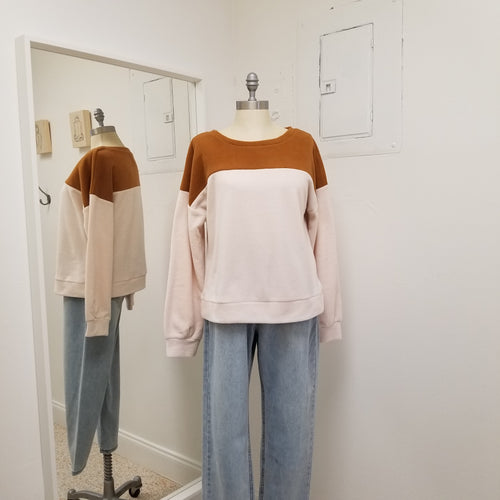 camel and off white color block fleece style sweatshirt with loose banded bottom