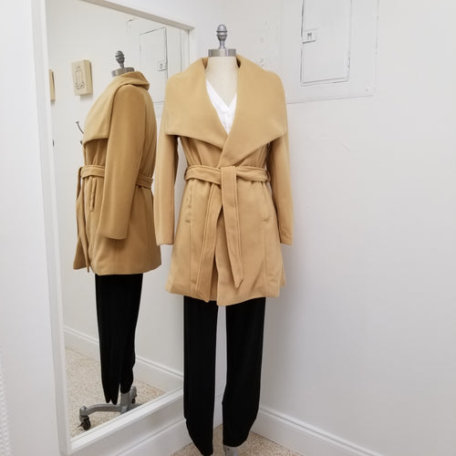 camel trench coat in medium weight with large lapel front pockets and soft belt mid length