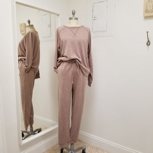 mauve jogger set with crew neck style top with a loose waistband, bottoms have drawstring waistband and pockets