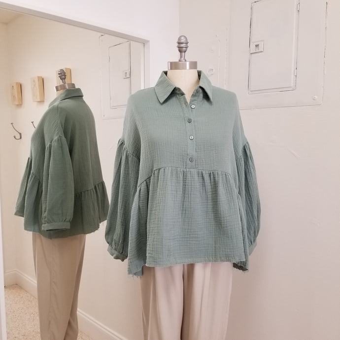 beryl green long sleeve babydoll style top with raw edge finish collared and 5 front buttons