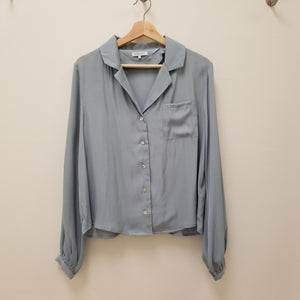 light blue silk blouse