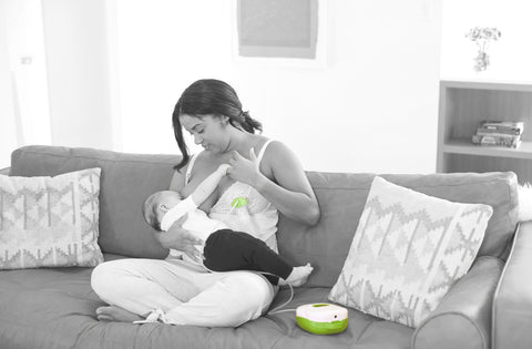 Mother breastfeeding with Ardo breastpump