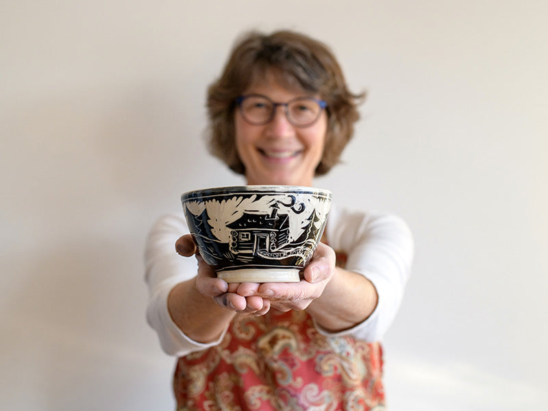 Artist Karen Gray with pottery bowl